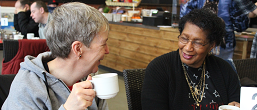 Two women chatting in a cafe.