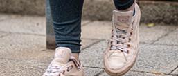 Feet walking down steps