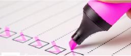 Ticking boxes with a pink highlighter pen