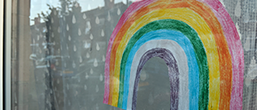 A drawing of a rainbow in a window