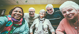 Five older men and women smiling at the camera