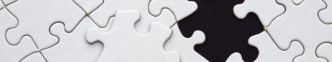 Black and white jigsaw with a piece missing